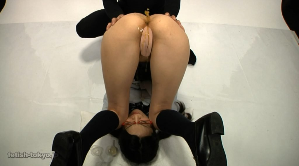 Schoolgirl in glasses shitting and enema on own face - 3