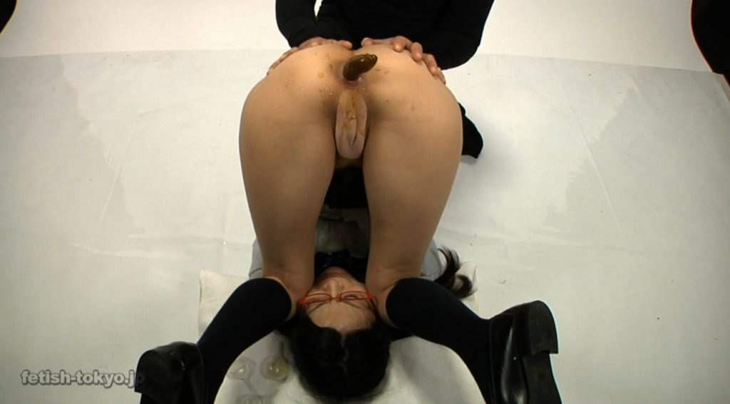 Schoolgirl in glasses shitting and enema on own face - 4