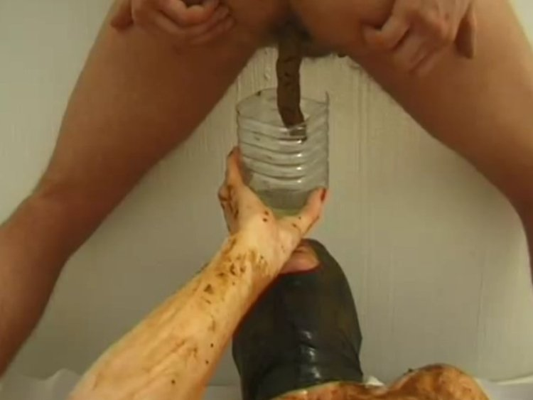 Slave girl in mask and Shitting male