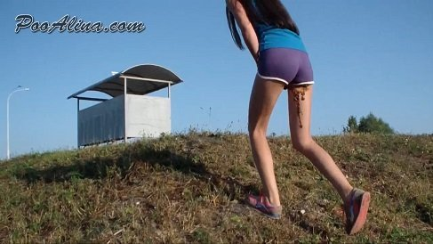 PooAlina – Sports girl crapped in shorts, walking and posing (PooAlina.com)