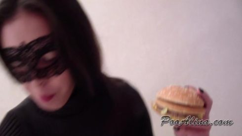 Girl_eats_hamburger_and_pooping._Close-up..mp4.00000.jpg